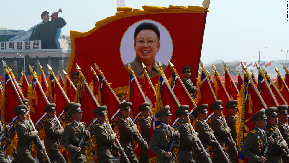 North Korean soldiers carry a portrait of late leader Kim Jong Il on Sunday.