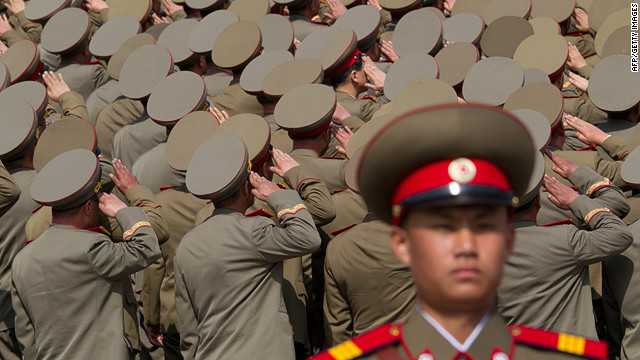 North Korean soldiers salute during a military parade to mark 100 years since the birth of the country's founder Kim Il-Sung on April 15.