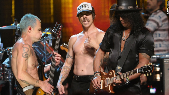 Flea (left), Anthony Keidis (center) and Slash perform at the 27th Annual Rock And Roll Hall of Fame Induction Ceremony.