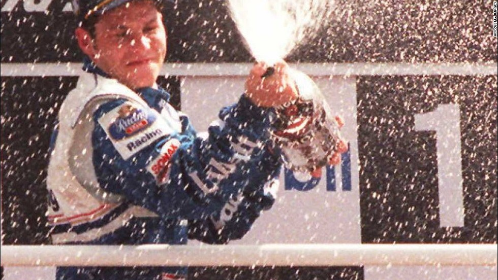 Jacques Villeneuve showers the crowd with champagne after winning the1994 British Grand Prix. He became the first Canadian to win the world title three years later -- a feat his father Gilles could not manage.