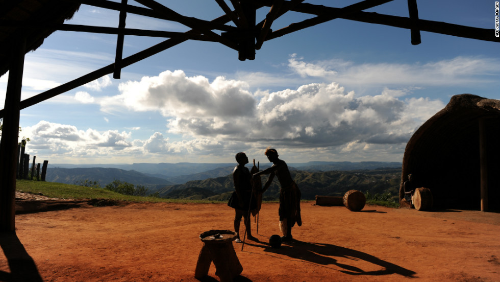 Members of South Africa's Zulu tribe dance on top of the famous Valley of a Thousand Hills on the outskirts of Durban. The area is named after the hills that tumble down to the Umgeni River.