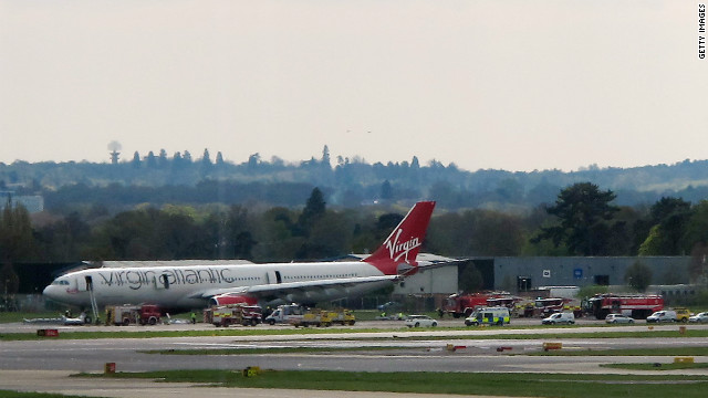 A Virgin Atlantic aircraft stands on the tarmac with emergency service vehicles in support after making an emergency landing at Gatwick Airport, London.