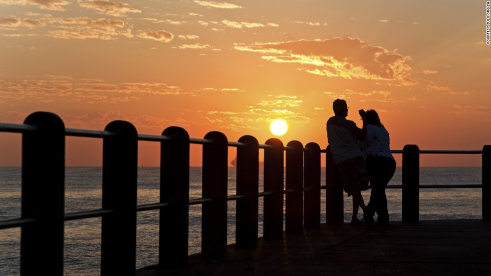 The sun sets over the Durban Pier. The cosmopolitan city of 3.5 million residents has undergone dramatic modernization over the last half century, but with a number of exquisite blue-flag beaches, the region still retains some of its natural charm.