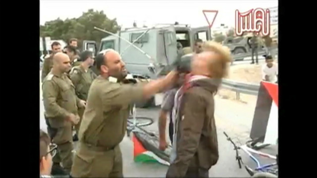Israeli soldier hits activist with gun