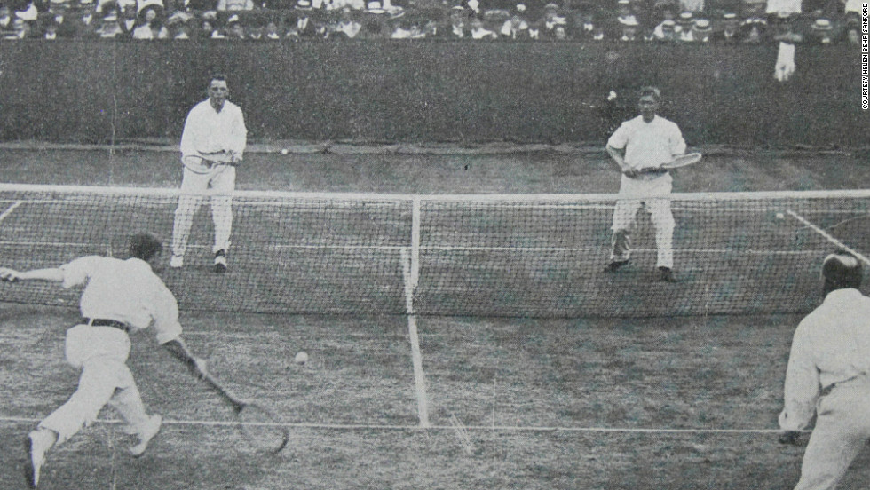 Behr and American partner Beals Wright (far end) playing in the doubles championship at the All England Club at Wimbledon.