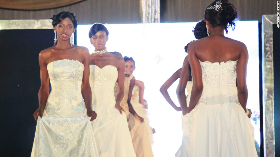 Models wear bridal gowns on the runway at the recent Lagos's Wed Expo wedding exhibition. Organizers say about 10,000 people attended over two days.