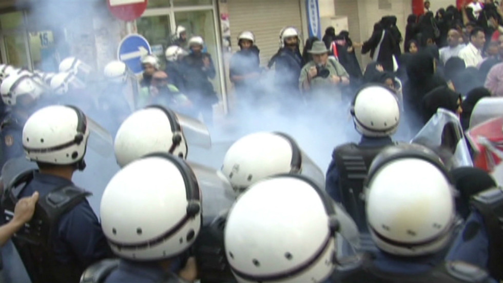 CNN's Fred Pleitgen went to Bahrain to report on the situation, and accompanied riot police as they confronted protesters in the streets.