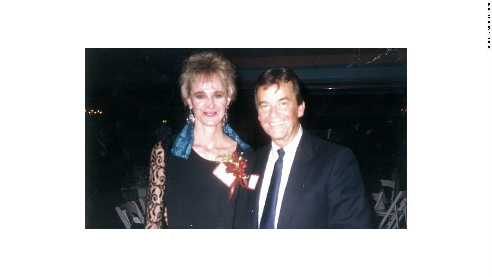 "Sioux Falcone, who worked with Clark in Los Angeles, posed with him at a 1980s holiday party. ""I pulled out the photo yesterday and here he is, wearing his name,"" Falcone said. ""I thought it was really endearing, and everyone had a name tag on, so I am sure he thought that he needed to do it, too."""