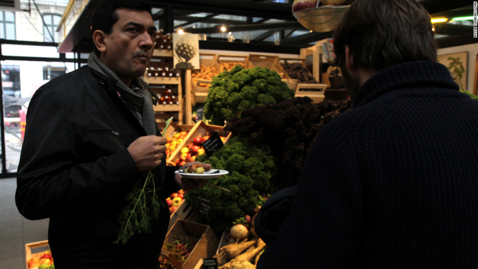Back in the city, Kapoor nibbles on a variety of freshly plucked vegetables sold at one of Copenhagen's many street-side grocery stores.