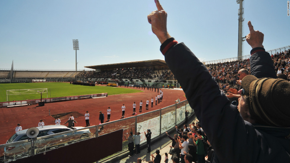 Mourners salute Morosini as a hearse carrying his coffin does a lap of the  stadium.