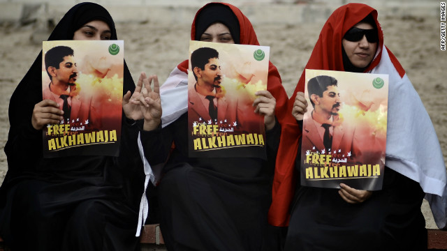 Bahraini demonstrators hold posters of Abdulhadi al-Khawaja during a protest calling for his release in on April 6, 2012.
