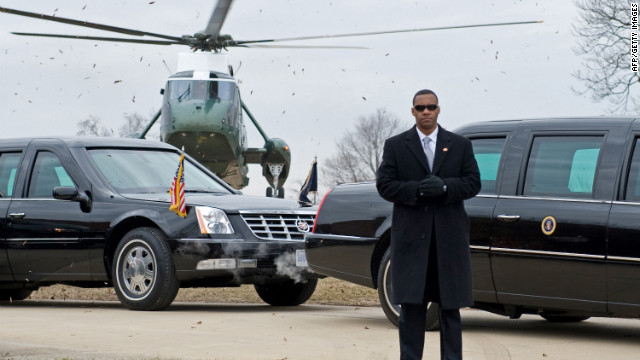 US Secret Service agent stands by President Obama's limousine at Fort McHenry in Baltimore in 2010.