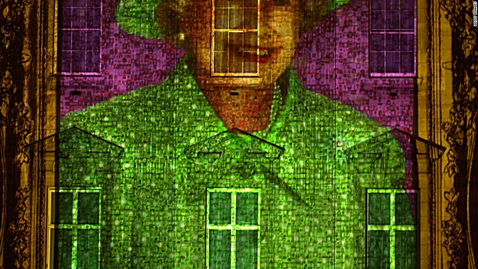 The Queen's image, made up of 200,000 self-portrait from children across the United Kingdom, is projected onto Buckingham Palace.