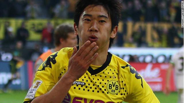 Shinji Kagawa celebrates after scoring Dortmund's second goal against Monchengladbach at Signal Iduna Park on Saturday.