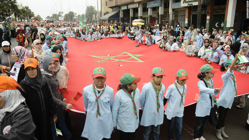 People gather around the Moroccan flag in the country's capital, Casablanca to mark Earth Day.
