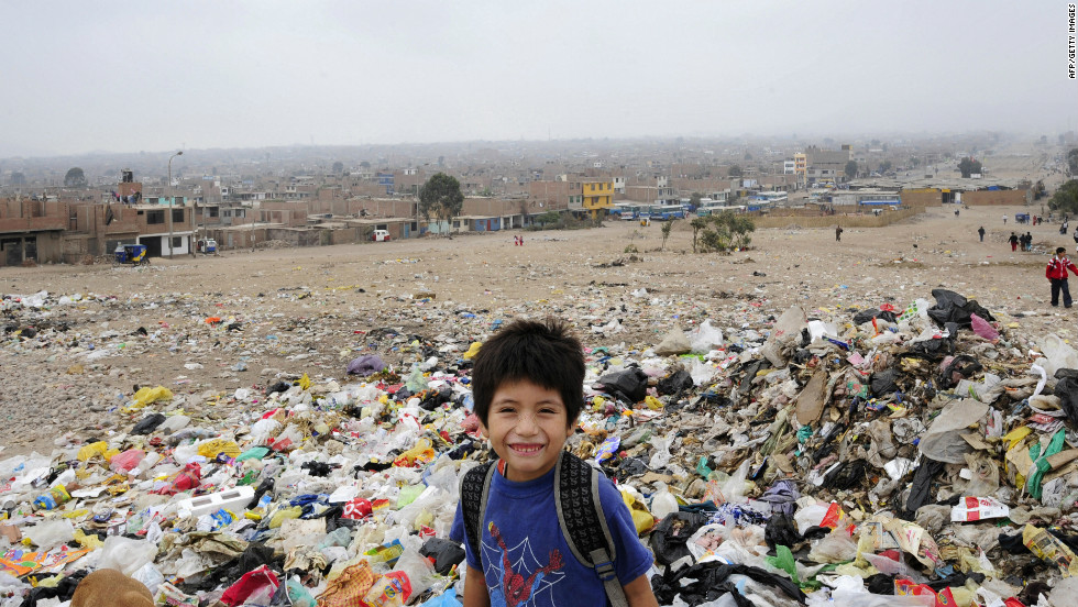 A Peruvian schoolboy smiles for the camera as he stands in a garbage dump -- one of Latin America's largest -- in the Villa el Salvador district on the outskirts of Lima.