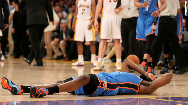 James Harden of the Oklahoma City Thunder lies on the court after being hit by Metta World Peace on Sunday.