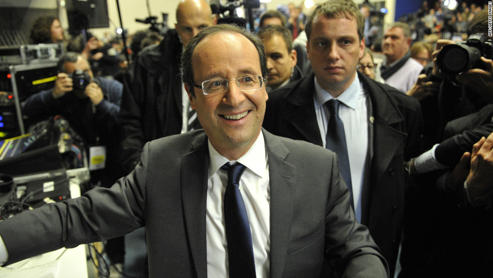 The Socialist Party's Francois Hollande leaves the election rally following the announcement of the estimated results of the first round of the presidential election.