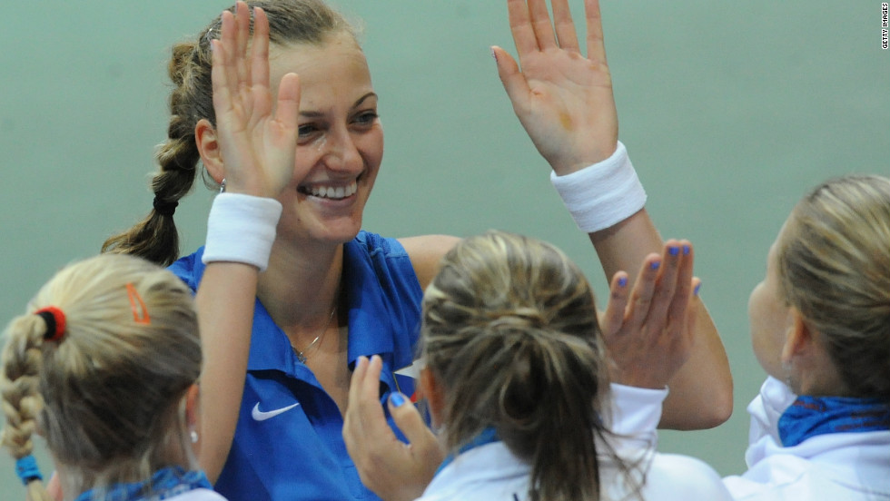 The Czech Republic's Petra Kvitova high-fives her teammates after defeating Italy's Francesca Schiavone as the defending champions won 4-1 in the other semifinal.