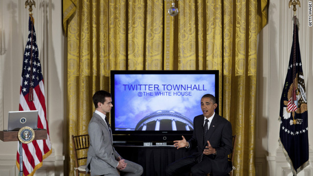 Twitter co-founder Jack Dorsey listens while President Barack Obama speaks during an online Twitter town hall meeting in 2011.