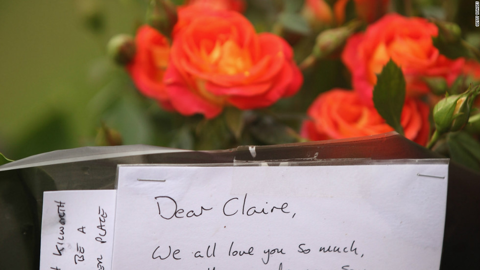 Floral tributes have been left on Birdcage Walk near St James's Park at the spot where Claire Squires collapsed and died.