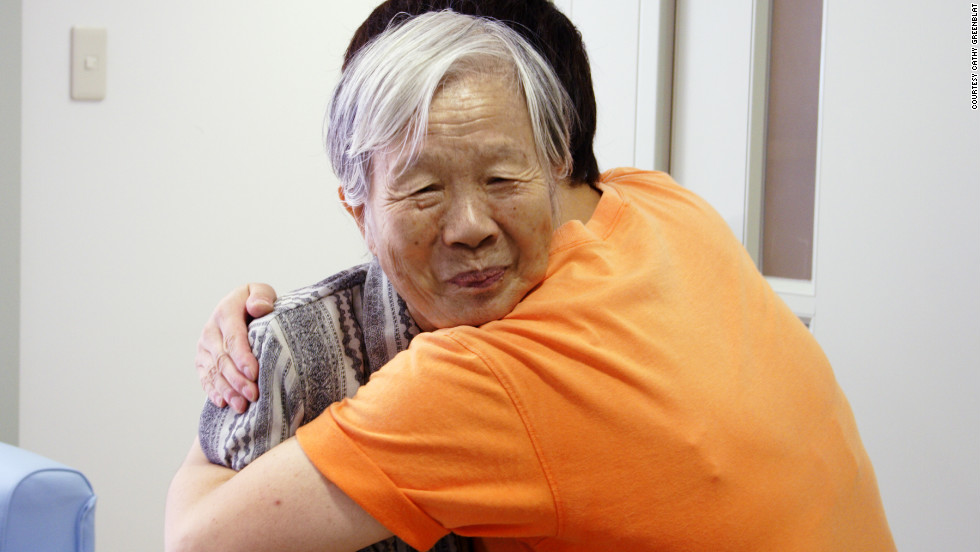 Also in Japan, an aide in a Kyoto group home embraced this unidentified resident living with Alzheimer's.