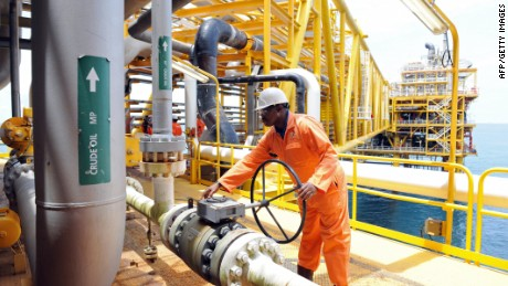 A worker inspect facilities on an upstream oil drilling platform at the Total oil platform at Amenem, 35 kilometers away from Port Harcourt in the Niger Delta.