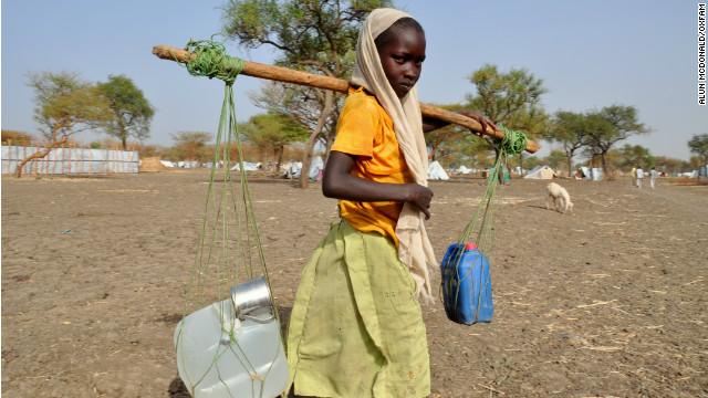 A young girl collects water at the Jamam Refugee Camp in South Sudan