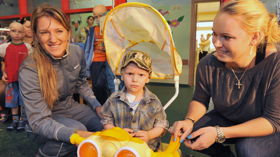 However, she still considers the Eastern European nation to be her home. Azarenka is pictured with former No. 1 Caroline Wozniacki (right) at a children's cancer center in Minsk in 2010.