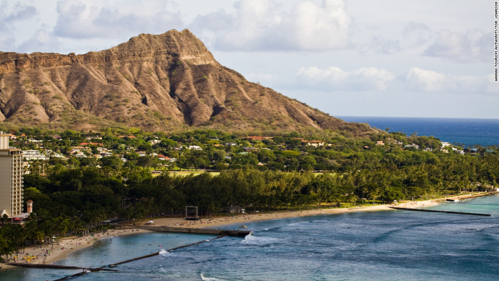 Diamond Head State Monument looms over Waikiki's coastline on the Hawaiian island of Oahu. While getting to the islands is bound to be expensive, it only costs $1 to visit Diamond Head on foot.