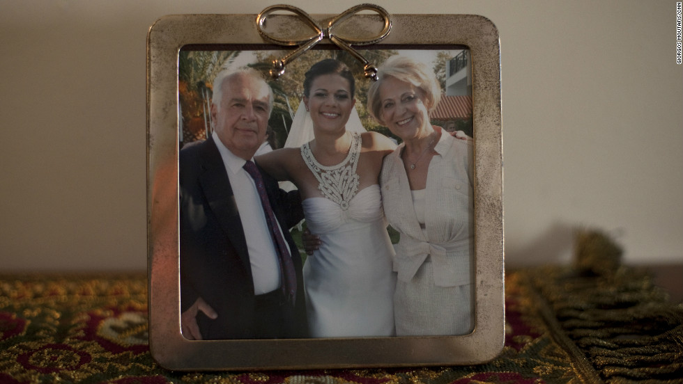 Angeliki Papathanasopoulou was killed days after Greece got its first bailout, when the bank she worked in was torched during protests. She married Christos Karapanagiotis -- her partner of 13 years -- in September 2009, nine months before she died.