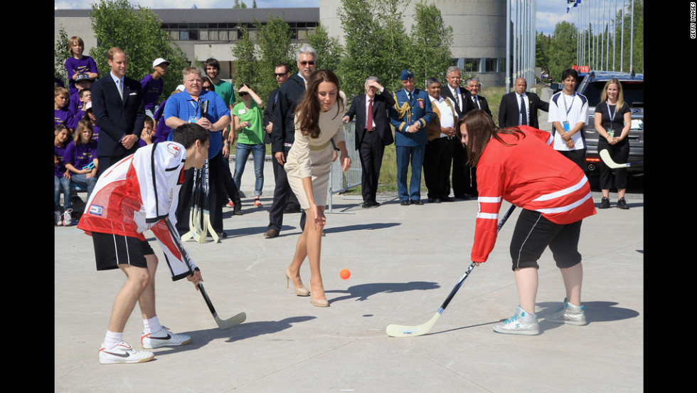 Catherine kicks off a street hockey game during an official welcome ceremony July 5 in Yellowknife, Canada.