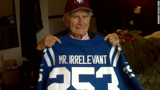 Paul Salata holds up this year's Mr. Irrelevant jersey in a New York hotel room.
