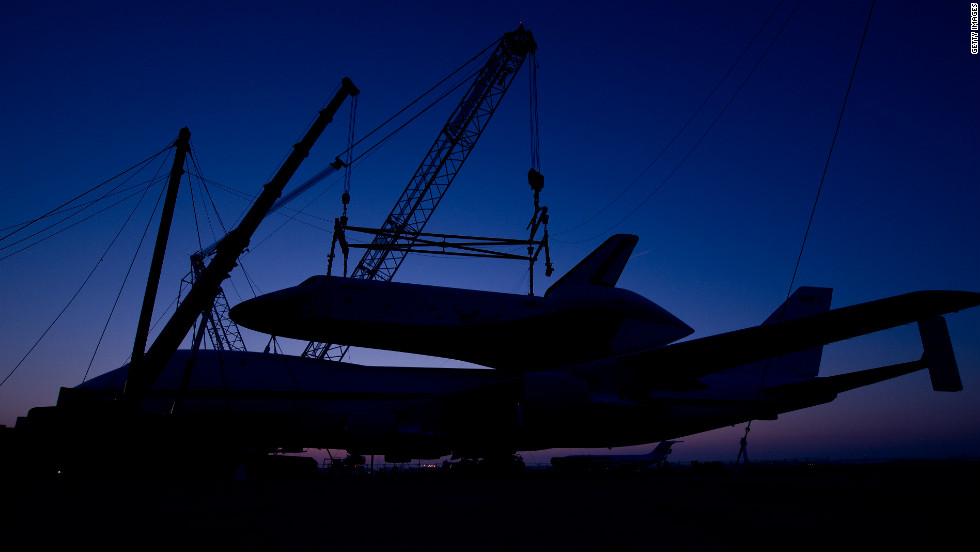 The Enterprise is mounted atop its carrier on April 20 in preparation for its final flight on April 27.