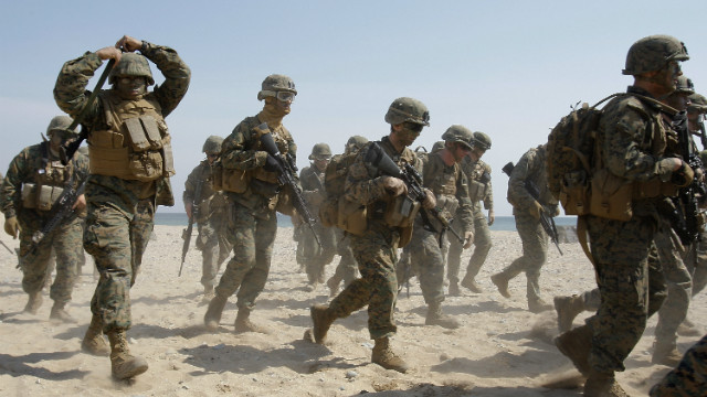 About 9,000 Marines will be transferred off the Japanese island of Okinawa under a U.S.-Japanese agreement.