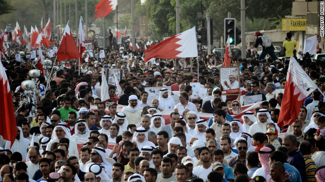 Bahraini Shiite Muslims march during a demonstration in the village of Jidhafs, west of Manama, on April 27, 2012.
