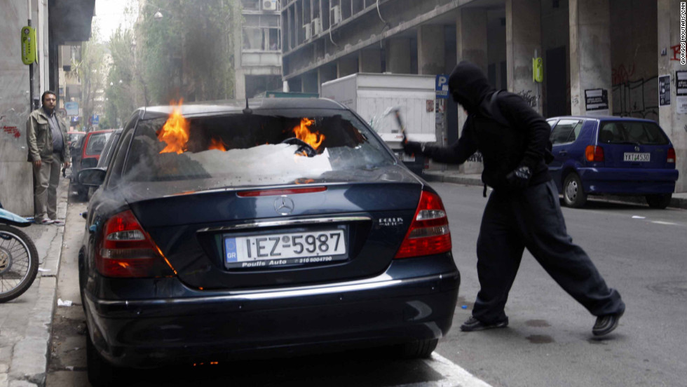 A picture of a rioter during the protests of May 5, 2010, on the corner of Patission and Kapodistriou Streets,  Athens.