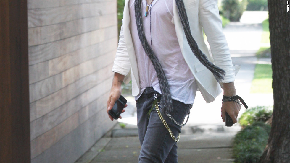 Russell Brand arrives at a studio in Los Angeles.