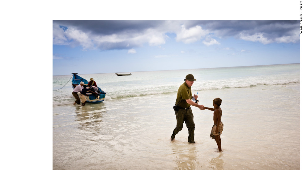 A traveler is greeted by a boy in a secluded bay that can only be reached by boat or on foot. Socotra is a group of four isolated islands off the coast of Yemen.