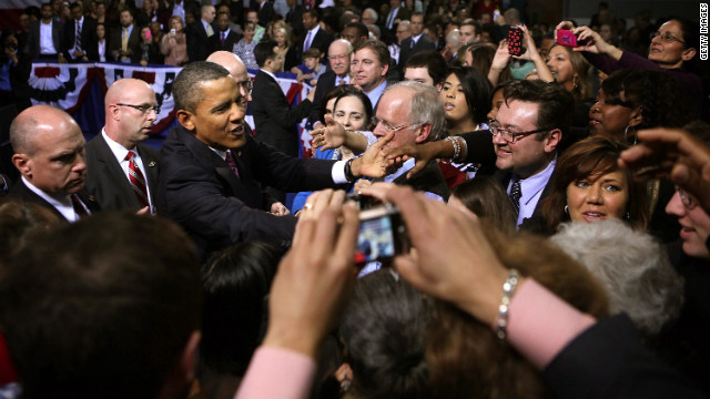 President Barack Obama shakes hands after delivering a speech on the economy in February in Falls Church, Virginia.