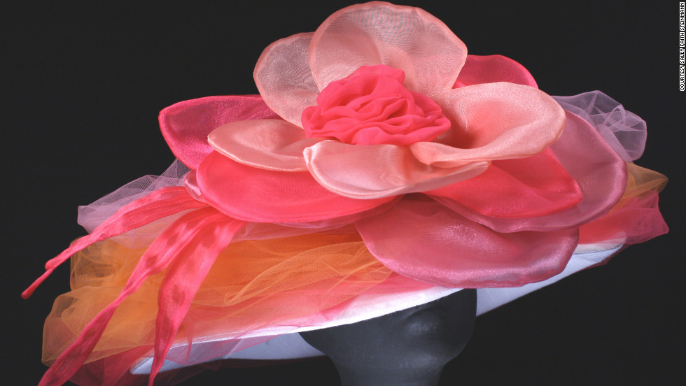 "This ""Candy"" creation by Steinmann showcases the bright pinks and flowers that Derby-goers love, like the fabric peony that dominates this wide brim design."