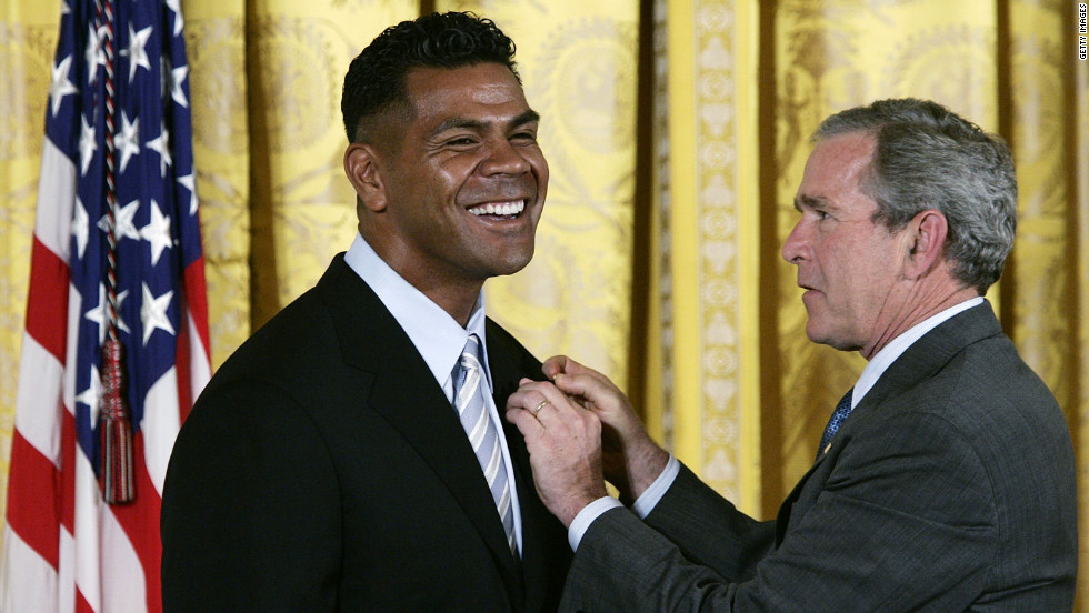 President George W. Bush presents Seau with the President's Volunteer Service Award In the East Room of the White House on May 25, 2005. The award was created to recognize Americans who have made a sustained effort to community service.