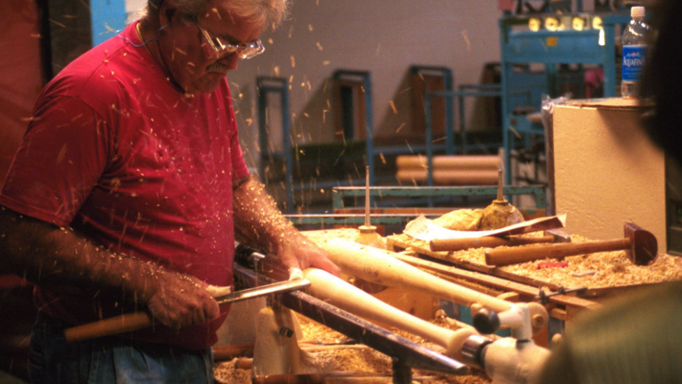 Workers used to turn all the bats by hand, and they're still trained to handcraft them for demonstrations.
