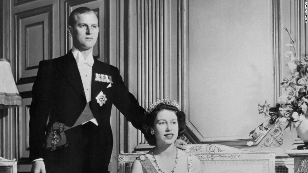 Princess Elizabeth and new husband, Prince Philip of Greece, pose for a royal photographer on their wedding day, 20 November 1947. By all accounts Prince Philip had won the future queen's heart by the age of 13.
