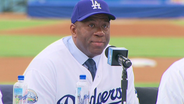 Magic teary as new owner of L.A. Dodgers