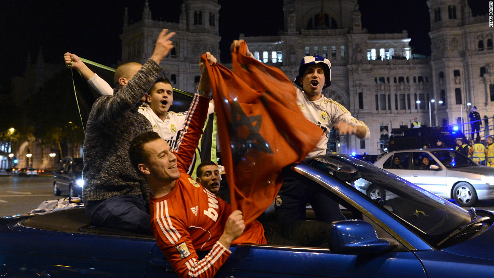 Real Madrid supporters celebrate their team's triumph, which was clinched with two games to play after a 3-0 win at Athletic Bilbao.