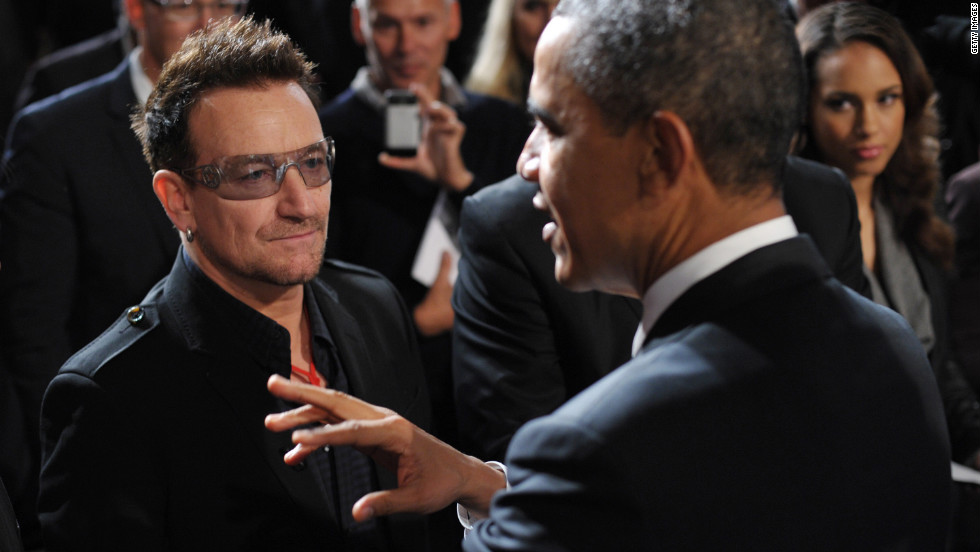 After speaking at a World AIDS Day event, Obama chats with U2's Bono as singer Alicia Keys looks on at George Washington University on December 1, 2011.