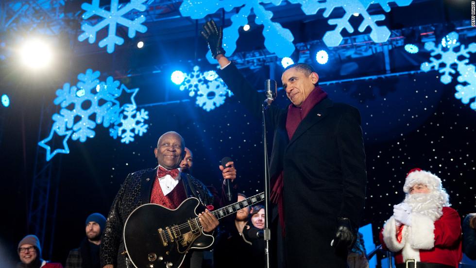 Obama waves alongside music legend B.B. King during the National Christmas Tree Lighting ceremony on December 9, 2010.