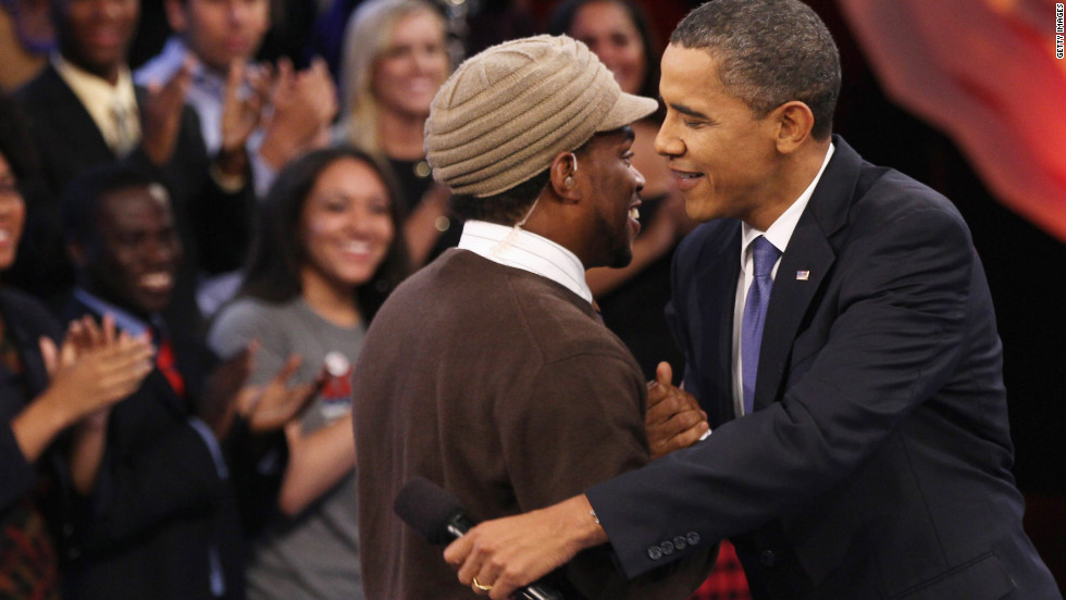 Before a youth-oriented town hall, Obama greets moderator Sway Calloway in Washington on October 14, 2010. The event was broadcast on MTV, BET and CMT.