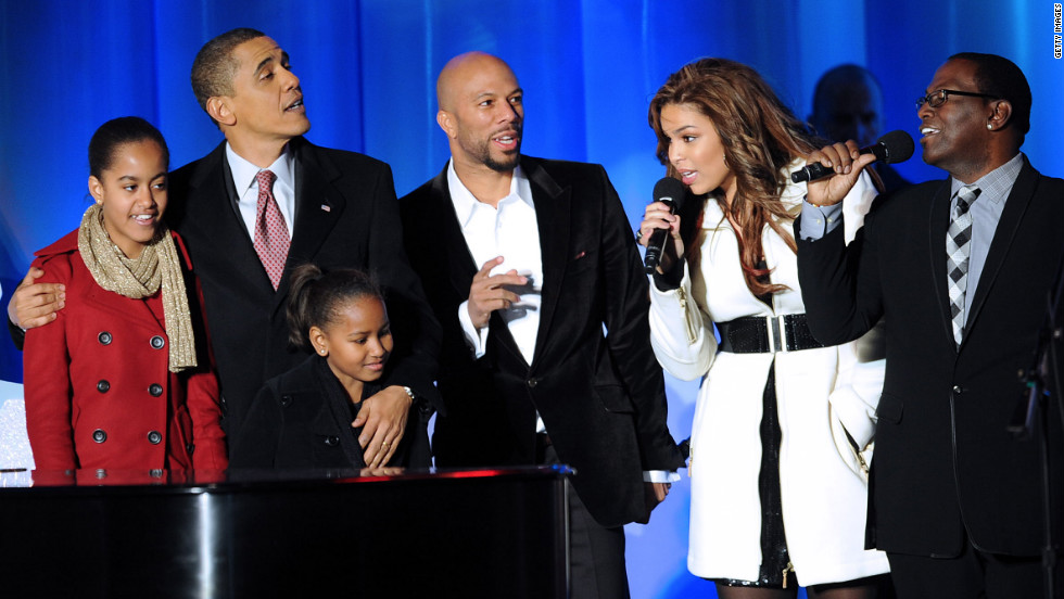 "Obama and his daughters, Malia and Sasha, sing with rapper Common, singer Jordan Sparks and ""American Idol"" judge Randy Jackson during the National Christmas Tree Lighting ceremony on December 3, 2009."